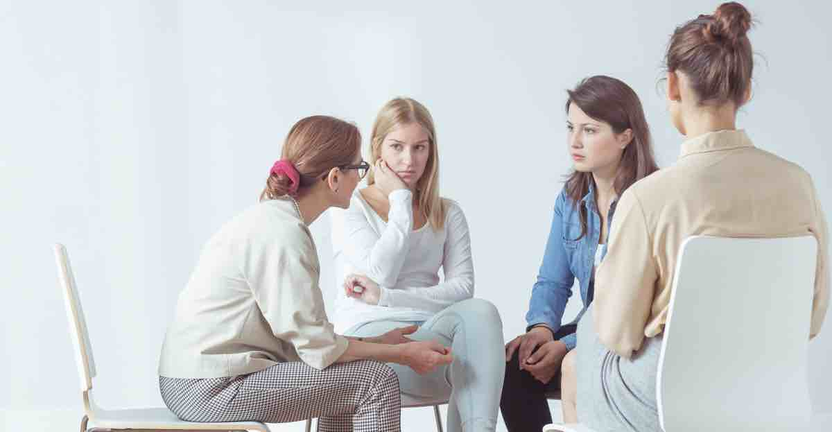 Counseling psychologist running a group session