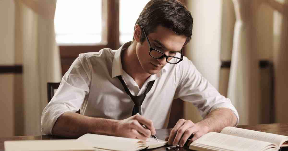 Male college student studying