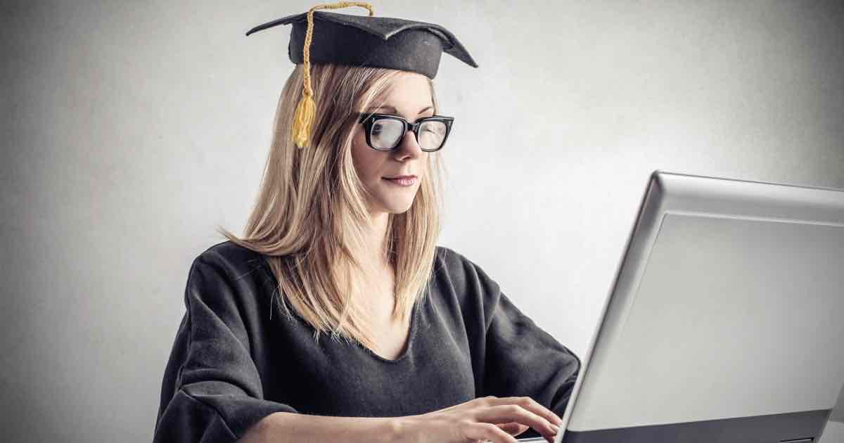 Online degree main image - graduating student with laptop