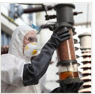 Woman wearing a hazard suit and mixing biochemicals